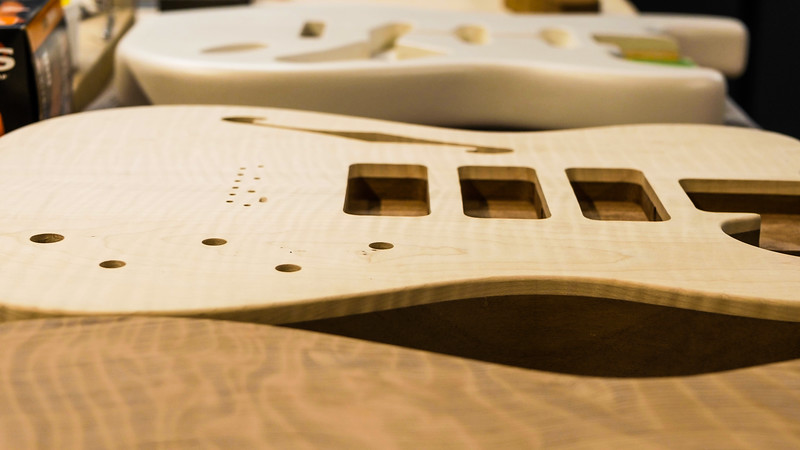 Unfinished guitar bodies sit on a table in the Lust for Tone guitar shop in Lake Worth on Monday, July 16, 2018. (Joseph Forzano / The Palm Beach Post)