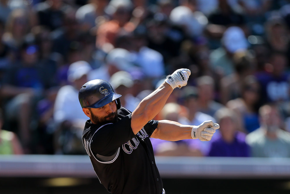 . Michael McKenry #8 of the Colorado Rockies looses his bat during the third inning against the Miami Marlins at Coors Field on August 24, 2014 in Denver, Colorado. The Rockies defeated the Marlins 7-4. (Photo by Justin Edmonds/Getty Images)