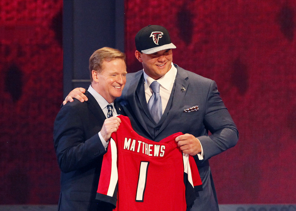 . Jake Matthews of the Texas A&M Aggies poses with NFL Commissioner Roger Goodell after he was picked #6 overall by the Atlanta Falcons during the first round of the 2014 NFL Draft at Radio City Music Hall on May 8, 2014 in New York City.  (Photo by Cliff Hawkins/Getty Images)