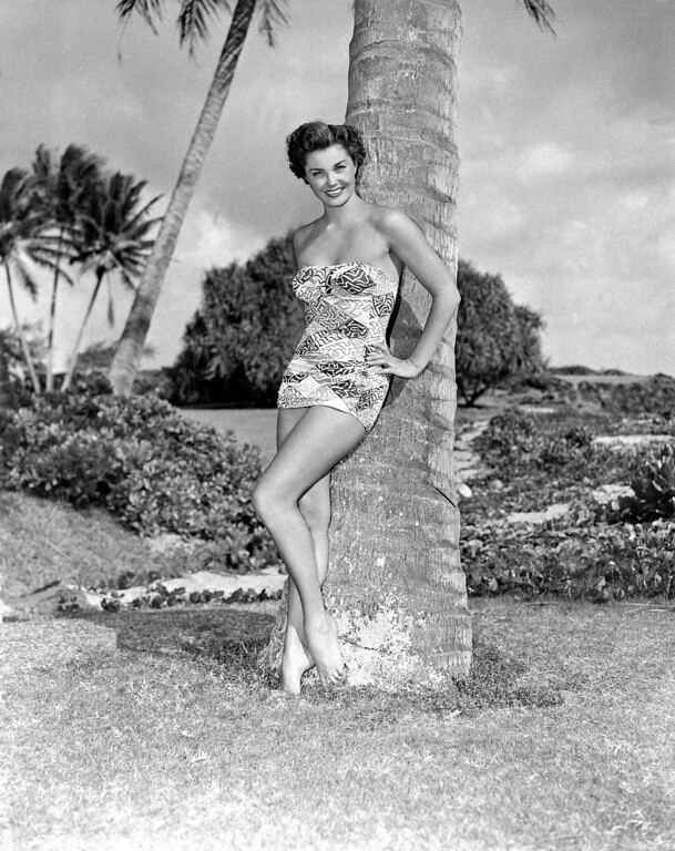 ". This April 1950 photo shows actress Esther Williams wearing a new swim suit of blue and white print by Cole of California, called ""Cracked Ice.\""  (AP Photo)"