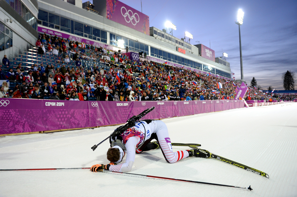 . Simon Eder of Austria collapses in the snow after the Men\'s Individual 20 km during day six of the Sochi 2014 Winter Olympics at Laura Cross-country Ski & Biathlon Center on February 13, 2014 in Sochi, Russia.  (Photo by Harry How/Getty Images)