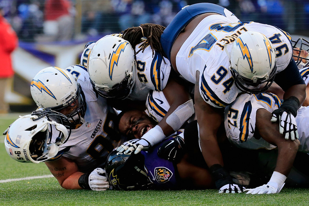 . BALTIMORE, MD - NOVEMBER 30: Inside linebacker Donald Butler #56 of the San Diego Chargers loses his helmet while making a fourth quarter tackle on running back Justin Forsett #29 of the Baltimore Ravens at M&T Bank Stadium on November 30, 2014 in Baltimore, Maryland.  (Photo by Rob Carr/Getty Images)