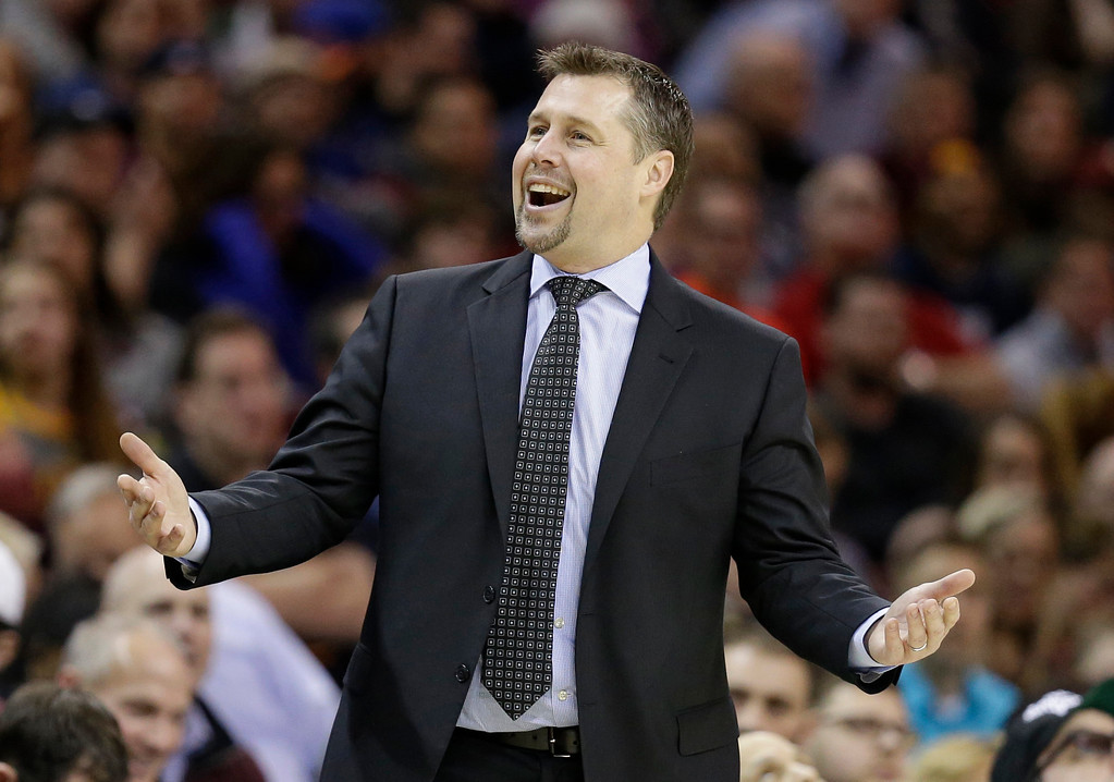 . Sacramento Kings coach David Joerger argues a call with a referee during the second half of the team\'s NBA basketball game against the Cleveland Cavaliers, Wednesday, Jan. 25, 2017, in Cleveland. The Kings won 116-112 in overtime. (AP Photo/Tony Dejak)