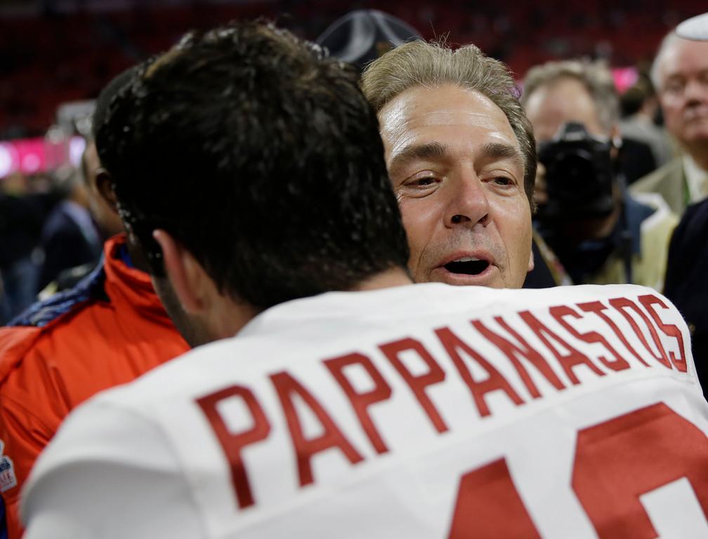 . Alabama head coach Nick Saban hugs Andy Pappanastos after overtime of the NCAA college football playoff championship game against Georgia, Monday, Jan. 8, 2018, in Atlanta. Alabama won 26-23. (AP Photo/David Goldman)