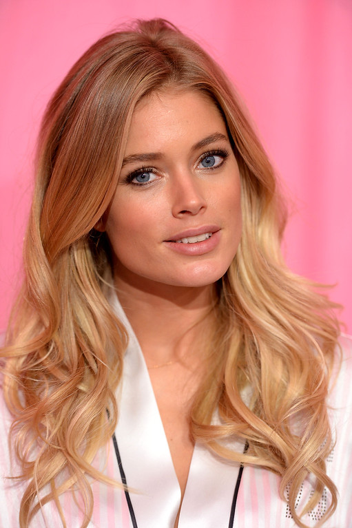 . Model Doutzen Kroes prepares at the 2013 Victoria\'s Secret Fashion Show hair and make-up room at Lexington Avenue Armory on November 13, 2013 in New York City.  (Photo by Dimitrios Kambouris/Getty Images for Victoria\'s Secret)