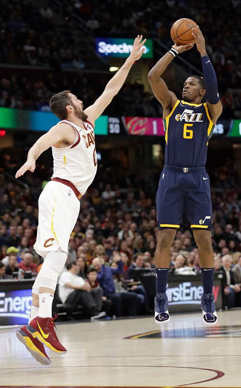 . Utah Jazz\'s Joe Johnson (6) shoots over Cleveland Cavaliers\' Kevin Love (0) in the first half of an NBA basketball game, Saturday, Dec. 16, 2017, in Cleveland. (AP Photo/Tony Dejak)