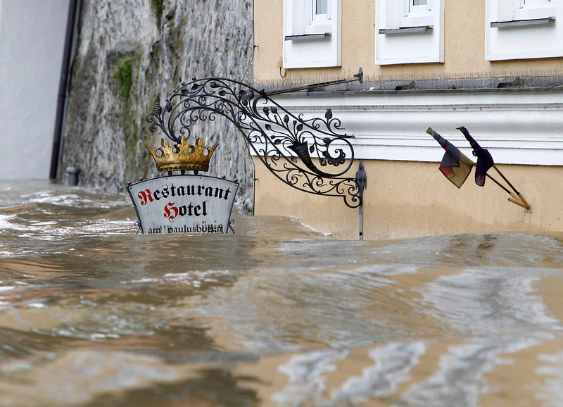 . The sign above the door of restaurant and hotel \'Am Paulusbogen\' is partially submerged in the flooded centre of the Bavarian town of Passau, about 200 km (124 miles) north-east of Munich June 3, 2013. Torrential rain in the south and south-east of Germany caused heavy flooding over the weekend, forcing people to evacuate their homes.    REUTERS/Michaela Rehle