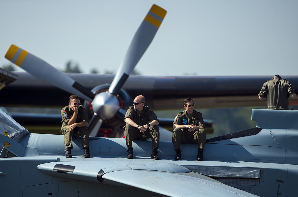 . German soldiers sit on a tornado aircraft at the International Air Show ILA in Schoenefeld near Berlin on May 20, 2014. Turkey is partner country of this year\'s aerospace trade show that runs until May 25, 2014. AFP PHOTO / JOHANNES EISELE/AFP/Getty Images