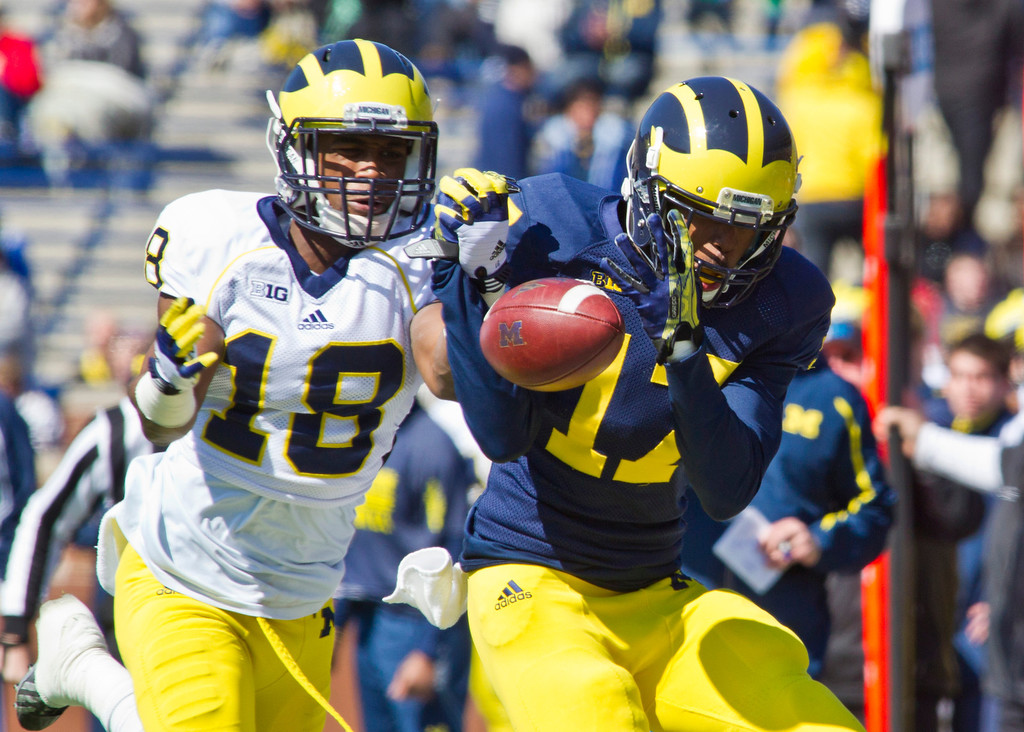 . Michigan defensive back Blake Countess (18) breaks up a pass intended for wide receiver Freddy Canteen (17), during the football team\'s annual spring game, Saturday, April 5, 2014, in Ann Arbor, Mich. (AP Photo/Tony Ding)