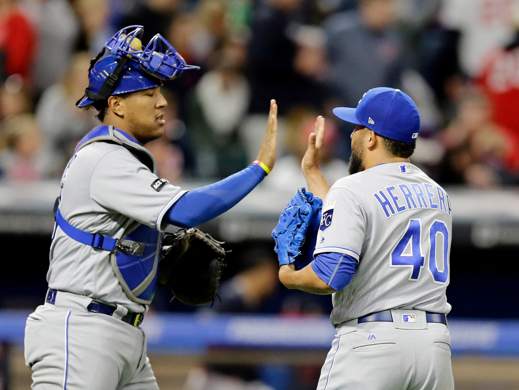 . Kansas City Royals relief pitcher Kelvin Herrera, right, and catcher Salvador Perez celebrate after they defeated the Cleveland Indians in a baseball game, Friday, May 26, 2017, in Cleveland. (AP Photo/Tony Dejak)