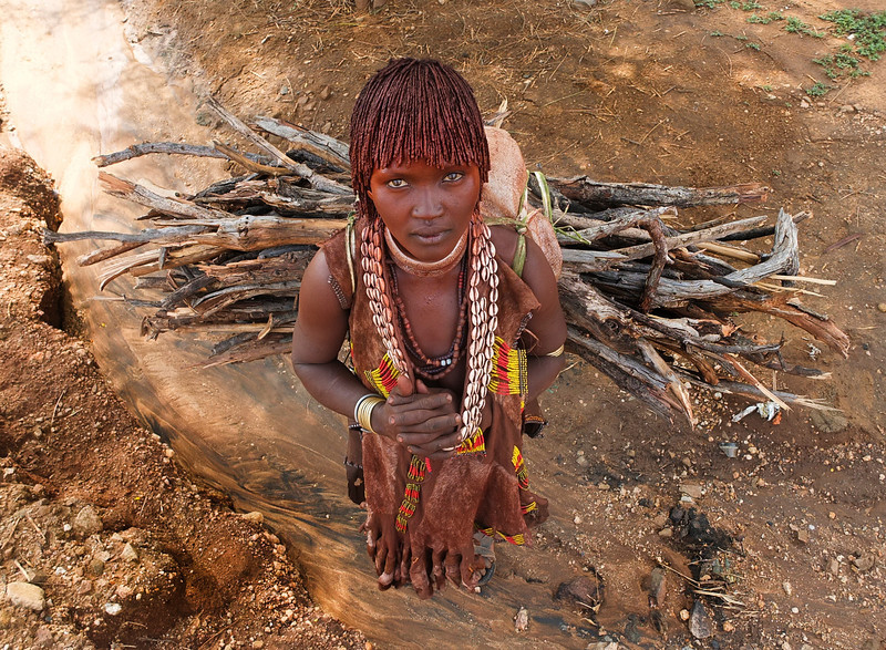 This is Kato from the Hamer tribe. Kato lives in a small village near the town of Turmi together with her husband and his other two wives. Kato is the second wife as symbolized by the two metal necklaces she wears.  Omo Valley, Southern Ethiopia, 2013.