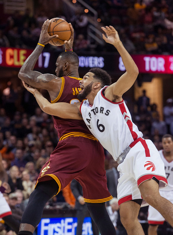 . Toronto Raptors\' Cory Joseph (6) fouls Cleveland Cavaliers\' LeBron James during the second half of an NBA basketball game in Cleveland, Tuesday, Nov. 15, 2016. The Cavaliers won 121-117. (AP Photo/Phil Long)