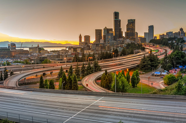 Seattle,Modern,Skylines,And,Rush,Hour,Traffic,On,Highway,I-90
