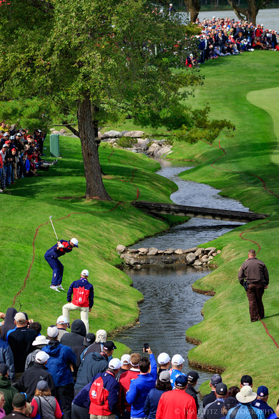 Dustin Johnson hitting ihs second shot from inside the hazard on #7. Ryder Cup, Hazeltine National Golf Course.