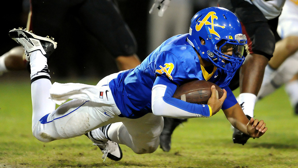 . Bishop Amat quarterback Koa Haynes (C) scrambles against Alemany in the first half of a prep football game at Bishop Amat High School in La Puente, Calif., on Friday, Oct. 25, 2013.    (Keith Birmingham Pasadena Star-News)