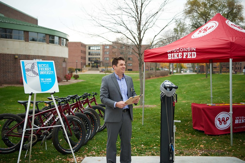 "Bike; Biking; Candid; cloudy; Club; day; Daytime; Fall; Group; Man men; November; Outside; ""Recreational Eagle Center; REC""; Speaking; Student students; Woman women"