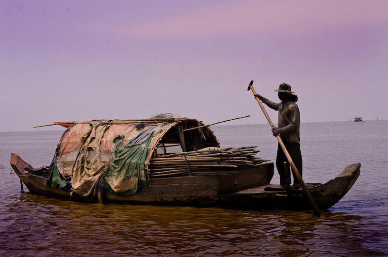 CambodiaTonleSapBoat&ManDSC_6323.jpg
