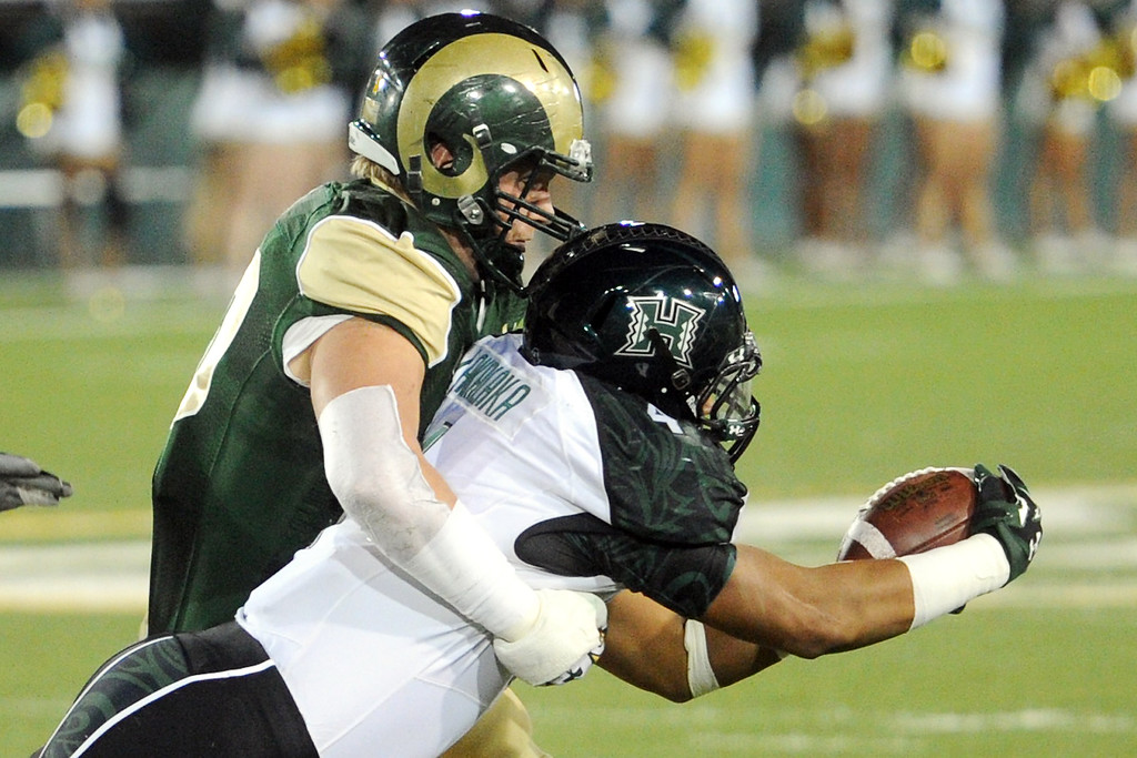 . 1109 SPO CSU football_03-srs.jpg Colorado State linebacker Max Morgan, left, tackles Hawaii running back Steven Lakalaka in the first quarter Saturday, Nov. 8, 2014, at Hughes Stadium. (Photo by Steve Stoner/Loveland Reporter-Herald)