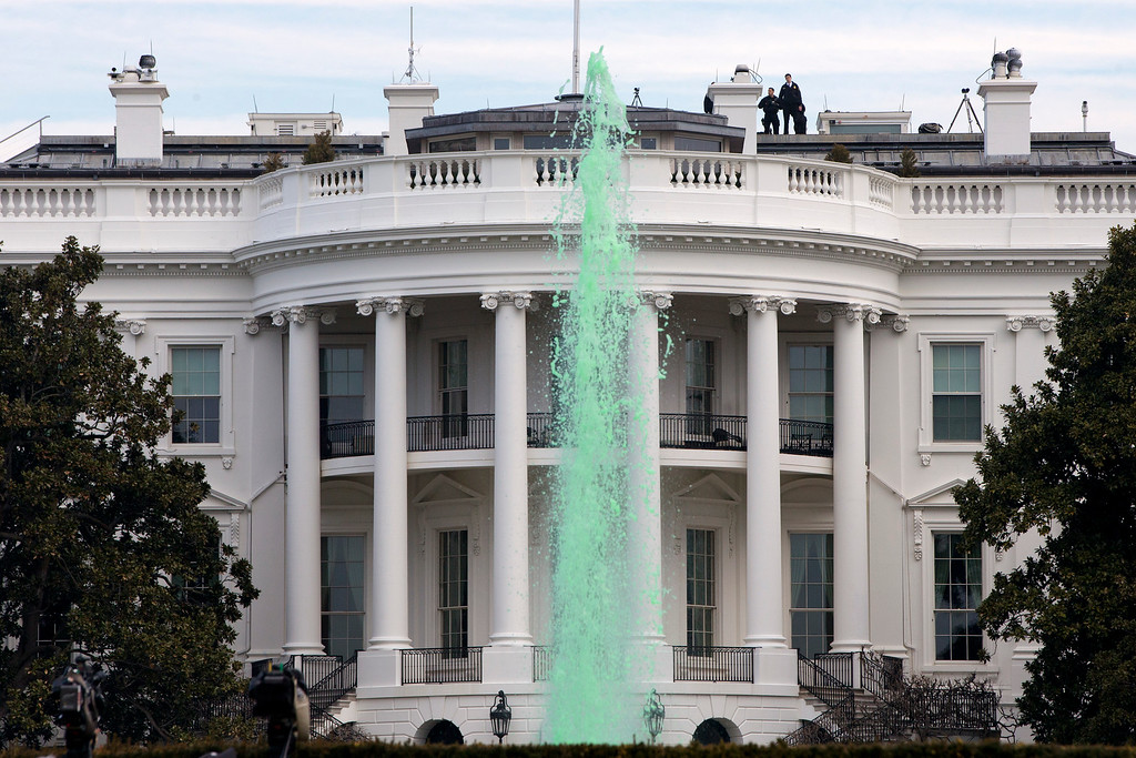 . Members of the Secret Service patrol the top of the White House in Washington, Tuesday, March 17, 2015, as while a fountain has been dyed green for St. Patrick\'s Day. (AP Photo/Jacquelyn Martin)
