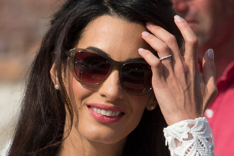 . Amal Alamuddin, wearing her nuptial ring, leaves the Aman hotel in Venice, Italy, Sunday, Sept. 28, 2014. Clooney and Amal married Saturday, Sept. 27, the actor\'s representative said, out of sight of pursuing paparazzi and adoring crowds.  (AP Photo/Andrew Medichini)