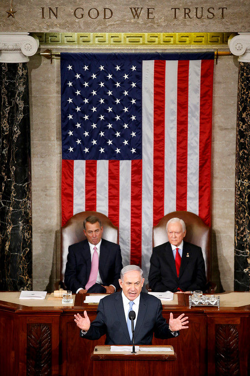 . Israeli Prime Minister Benjamin Netanyahu speaks before a joint meeting of Congress on Capitol Hill in Washington, Tuesday, March 3, 2015. Netanyahu is using the address to warn against trusting Iran to curb its nuclear ambitions. House Speaker John Boehner of Ohio, left, and Sen. Orrin Hatch, R-Utah, listen.  (AP Photo/Andrew Harnik)