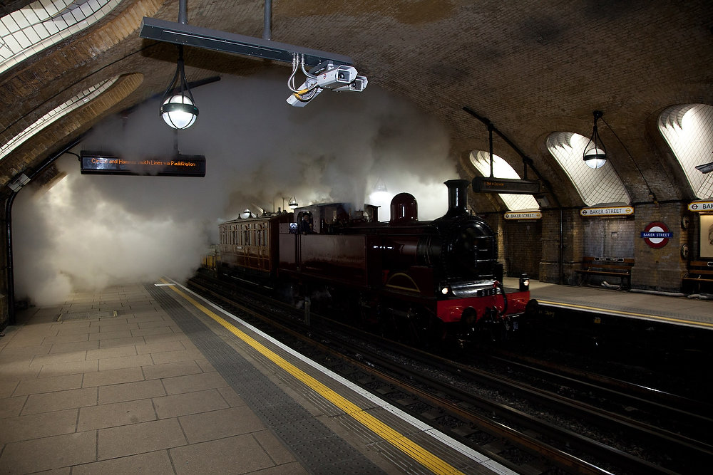 Description of . A restored steam engine travels into the Baker Street underground station in central London on December 16, 2012. The engine, known as the Metropolitan Steam Locomotive No. 1 and built in 1898, was on a practice run in advance of celebrations to commemorate the 150th anniversary of the first underground railway journey on January 9, 1863. The journey took place through the new tunnels of the Metropolitan line between Paddington and Farringdon.  Photograph taken on December 16, 2012.   REUTERS/Paul Curtis/Transport for London/Handout