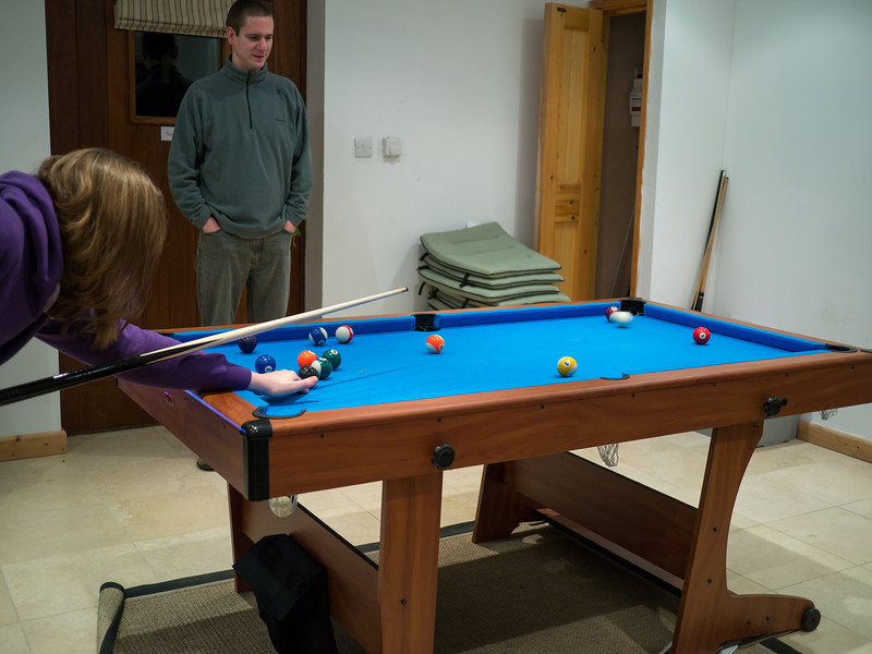 Playing pool in the games room