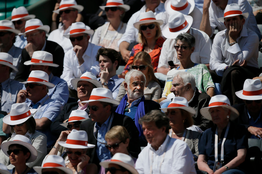 . French actor Jean-Paul Belmondo, center with blue scarf, watches Italy\'s Sara Errani defeat Poland\'s Agniezska Radwanska in two sets, 6-4, 7-6, in their quarterfinal match at the French Open tennis tournament, at Roland Garros stadium in Paris, Tuesday June 4, 2013. (AP Photo/Petr David Josek)
