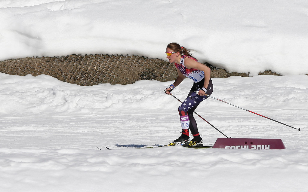 . Sophie Caldwell of the United States skis with a sleeveless top as temperatures go well over the freezing point during the women\'s 10K classical-style cross-country race at the 2014 Winter Olympics, Thursday, Feb. 13, 2014, in Krasnaya Polyana, Russia. (AP Photo/Matthias Schrader)