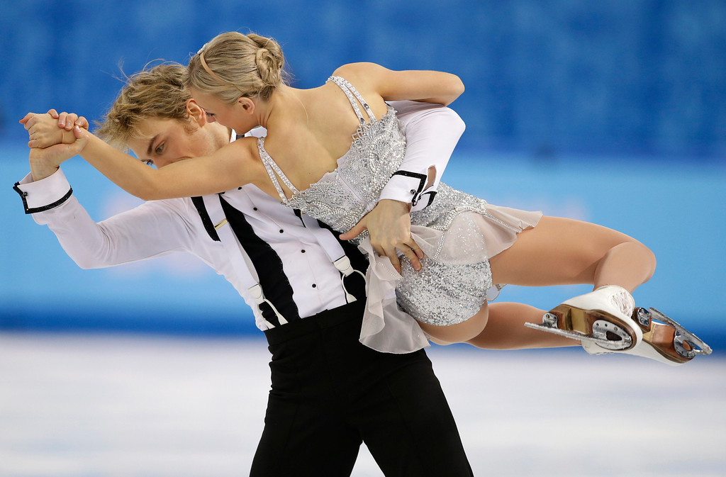 . Penny Coomes and Nicholas Buckland of Britain compete in the ice dance short dance figure skating competition at the Iceberg Skating Palace during the 2014 Winter Olympics, Sunday, Feb. 16, 2014, in Sochi, Russia. (AP Photo/Darron Cummings)