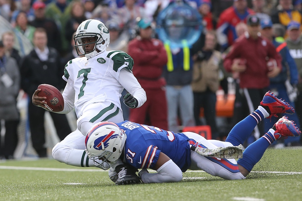 . Geno Smith #7 of the New York Jets is sacked during NFL game action by Jairus Byrd #31 of the Buffalo Bills at Ralph Wilson Stadium on November 17, 2013 in Orchard Park, New York. (Photo by Tom Szczerbowski/Getty Images)