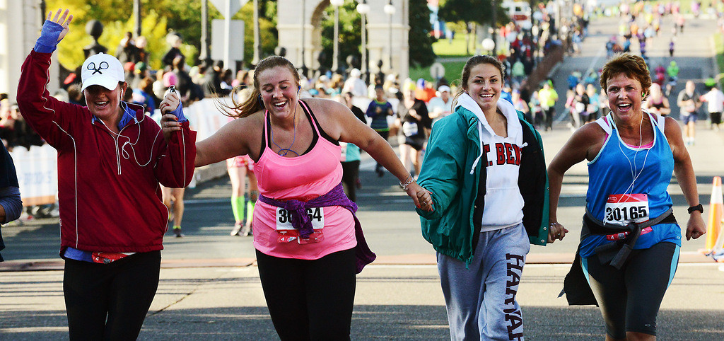 . Runners cross the finish line in the TC 10-Mile race near the State Capitol in St. Paul.  (Pioneer Press: Ben Garvin)