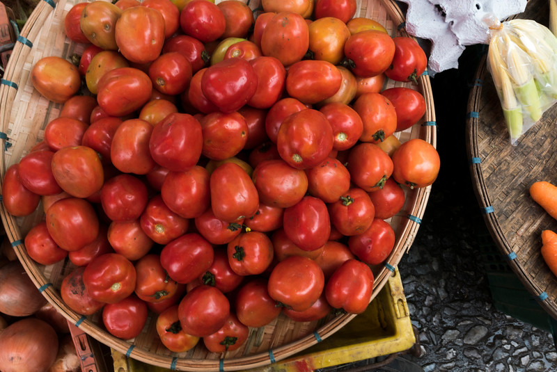 Basket of Tomatoes for sale at market stall, Luang Prabang, Laos
