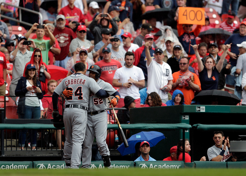 . Detroit Tigers\' Miguel Cabrera (24) gets a hug from teammate Yoenis Cespedes after hitting a solo home run during the first inning of a baseball game against the St. Louis Cardinals, Saturday, May 16, 2015, in St. Louis. (AP Photo/Jeff Roberson)