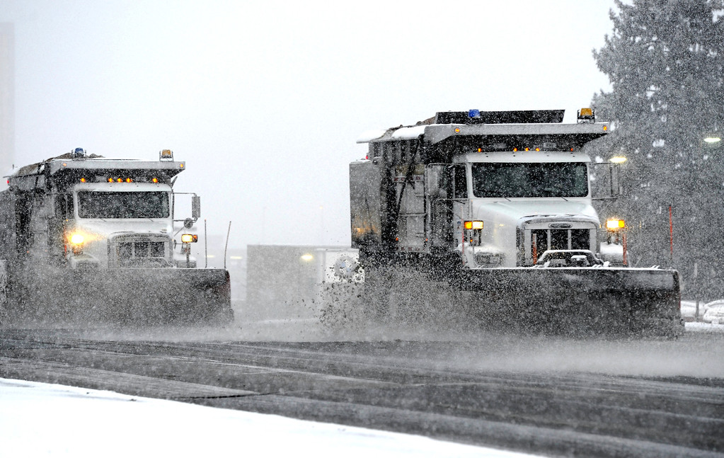 . Snow plows head south on Colorado Blvd clearing snow in Glendale Colorado during rush hour Wednesday evening, Feburary 20th, 2013. Andy Cross, The Denver Post