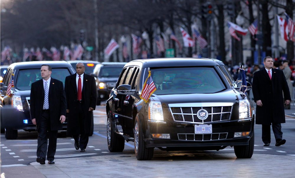 Description of . The presidential limousine with President Barack Obama and first lady Michelle Obama inside, heads down Pennsylvania Avenue in the Inaugural Parade after the ceremonial swearing-in for the 57th Presidential Inauguration on Capitol Hill in Washington, Monday, Jan. 21, 2013. (AP Photo/Susan Walsh)