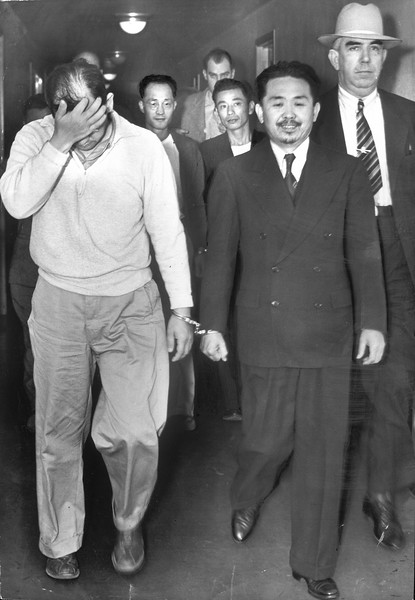 """""""'Troublemakers' at the Santa Anita reception center, these Japanese yesterday were arraigned on charges of conspiring to violate wartime orders"""" -- caption on photograph"""