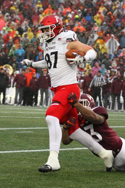 Virginia Tech cornerback #3 Caleb Farley tackles Cincinnati tight end #87 Bruno Labelle