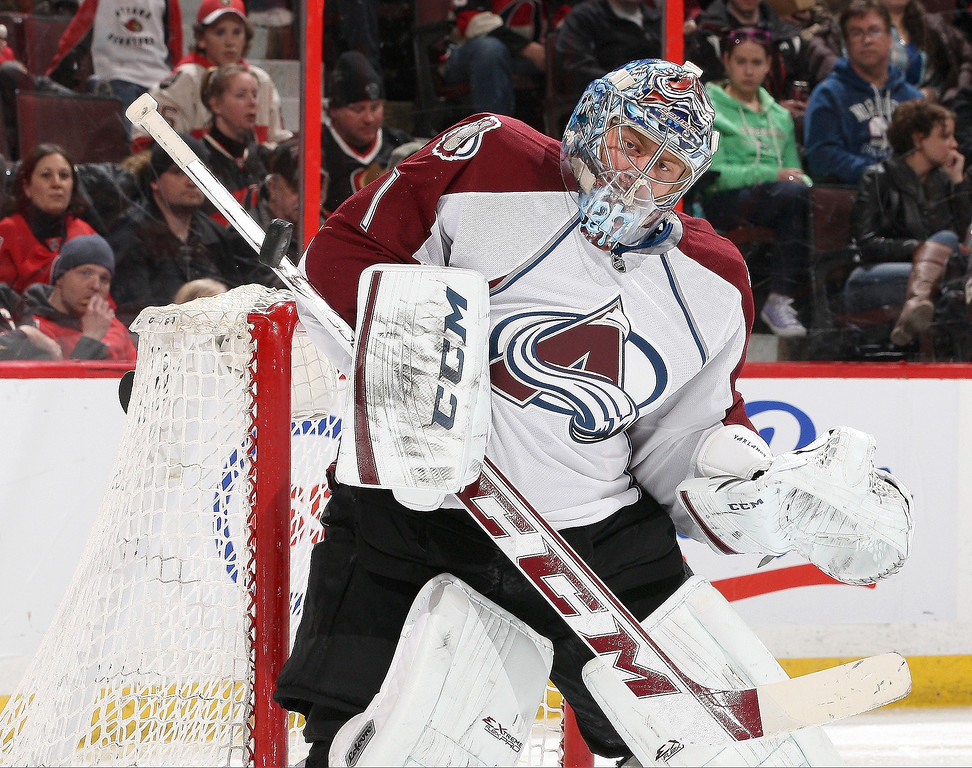 . Semyon Varlamov #1 of the Colorado Avalanche makes a save off his shoulder against the Ottawa Senators during an NHL game at Canadian Tire Centre on March 16, 2014 in Ottawa, Ontario, Canada.  (Photo by Jana Chytilova/Freestyle Photography/Getty Images)