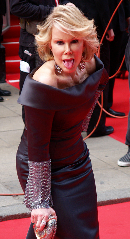. U.S. comedian Joan Rivers arrives at the British Academy Television Awards, BAFTA,  in London, Sunday May 20, 2007. (AP Photo/ Max Nash)