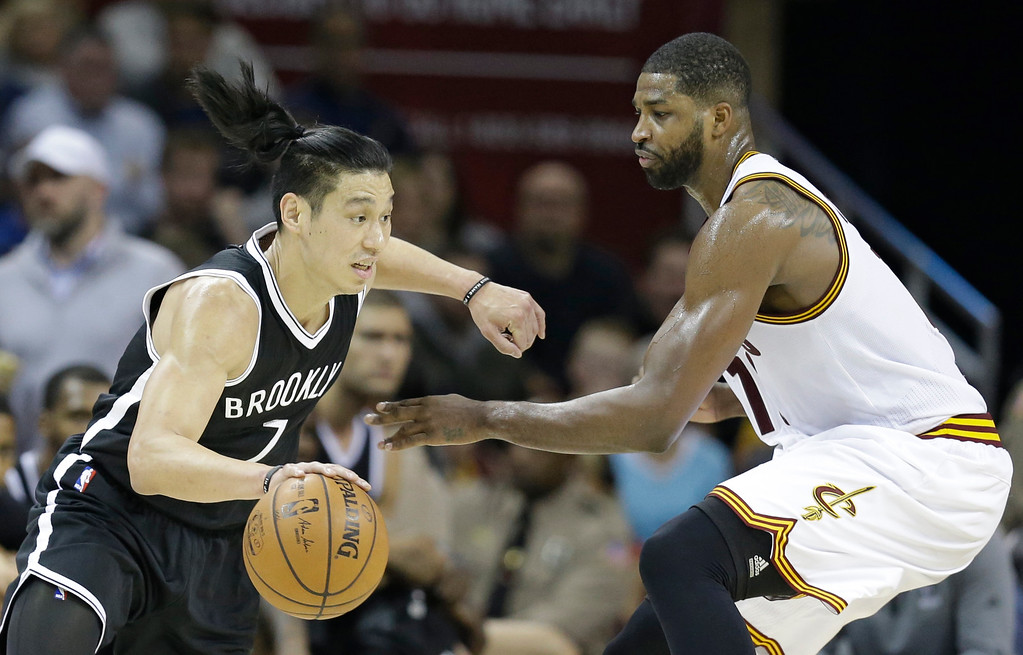 . Brooklyn Nets\' Jeremy Lin, left, drives past Cleveland Cavaliers\' Tristan Thompson in the second half of an NBA basketball game, Friday, Dec. 23, 2016, in Cleveland. (AP Photo/Tony Dejak)