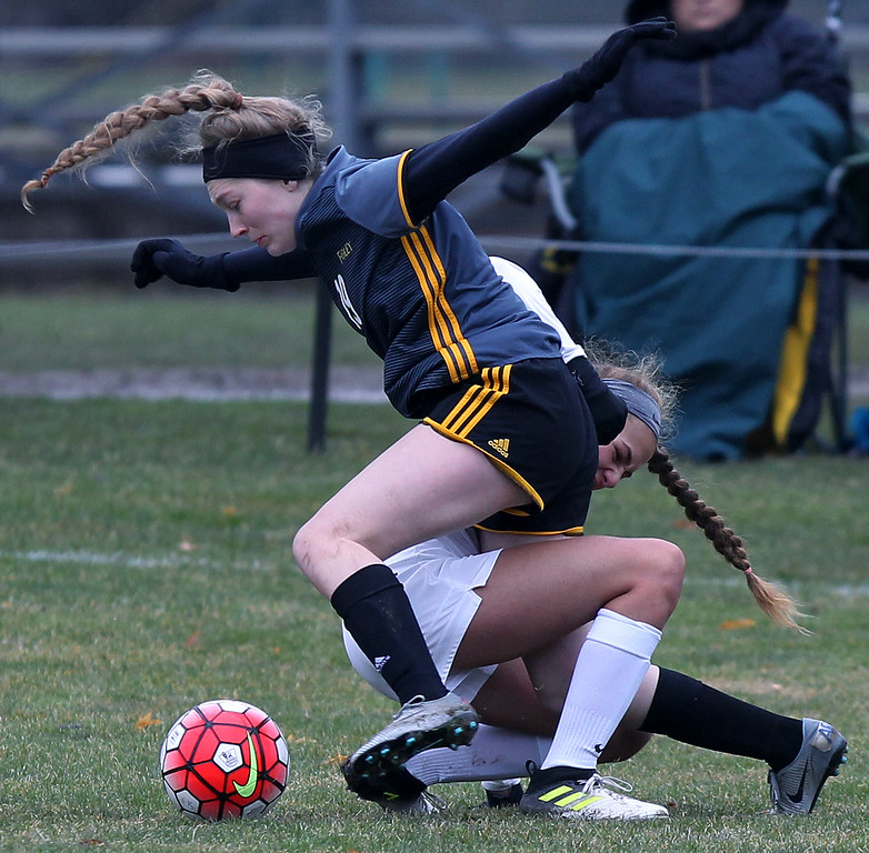 . Mackenzie Kopf (foreground), Madison Heights Bishop Foley, gets tangled up with Ellie Kwartowitz during varsity soccer action at Cranbrook-Kingswood Saturday, April 14, 2018. Foley tallied once in each half to down the Cranes 2-0. (For The Oakland Press / LARRY McKEE)