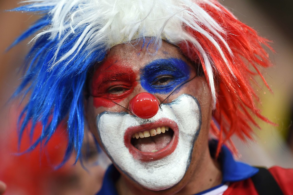 . A Chilean football fan waits for the start of the Group B football match between Chile and Australia at the Pantanal Arena in Cuiaba during the 2014 FIFA World Cup on June 13, 2014. AFP PHOTO / MARTIN BERNETTI/AFP/Getty Images