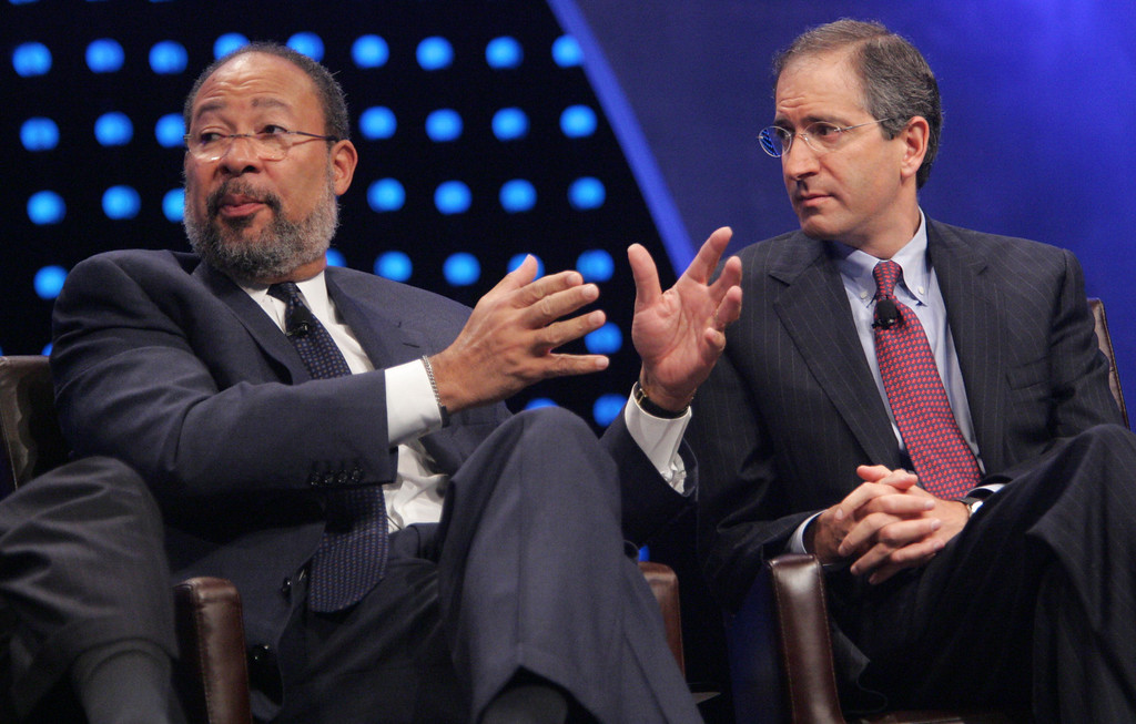 . Chairman & CEO of Time Warner Richard Parsons, left, speaks as Chairman & CEO of Comcast Brian Roberts listens during a panel discussion at the National Cable Television Association\'s annual conference held in Atlanta,  Monday, April 10, 2006. (AP Photo/John Amis)