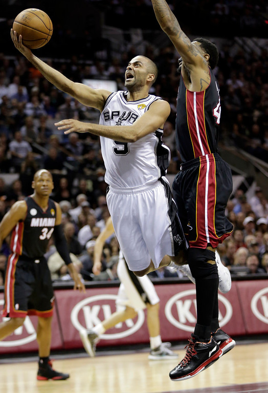 . San Antonio Spurs\' Tony Parker (9) shoots around Miami Heat\'s Udonis Haslem during the first half at Game 4 of the NBA Finals basketball series, Thursday, June 13, 2013, in San Antonio. (AP Photo/Eric Gay)