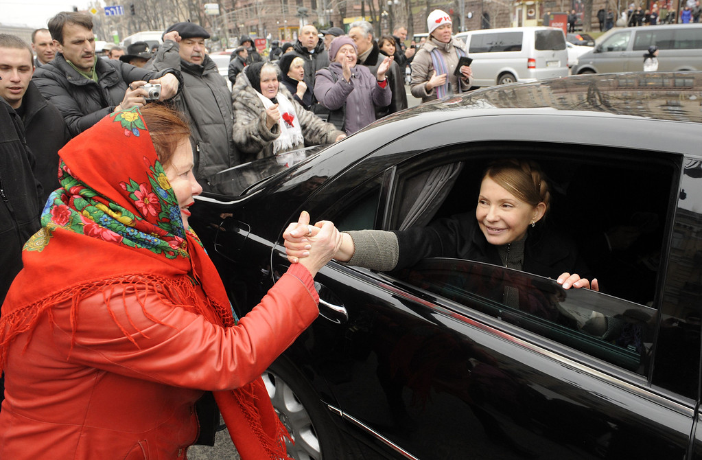 . Ukrainian opposition leader Yulia Tymoshenko shakes hands with a woman as she arrives to visit the tent camp of her supporters in the center of Kiev on February 28, 2014. Judicial authorities in Geneva said Friday they have launched a criminal investigation into alleged money laundering by ousted Ukrainian leader Viktor Yanukovych and his son. The Swiss government also announced it was freezing the assets of 20 Ukranian officials, including Yanukovych and his son and a number of former ministers. AFP PHOTO/ YURIY  DYACHYSHYN/AFP/Getty Images
