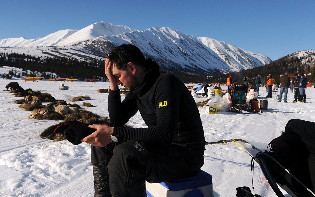 . In this March 3, 2014 photo, Ray Redington Jr. rests at the Rainy Pass checkpoint during the 2014 Iditarod Trail Sled Dog Race near Puntilla Lake, Alaska. (AP Photo/The Anchorage Daily News, Bob Hallinen)
