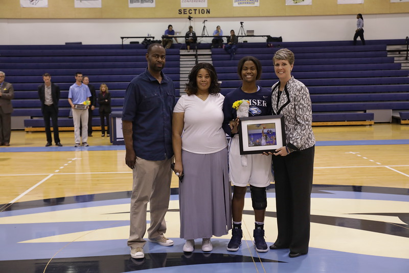 Keiser senior Jamilla Banks Wall with parents and Coach Oswald
