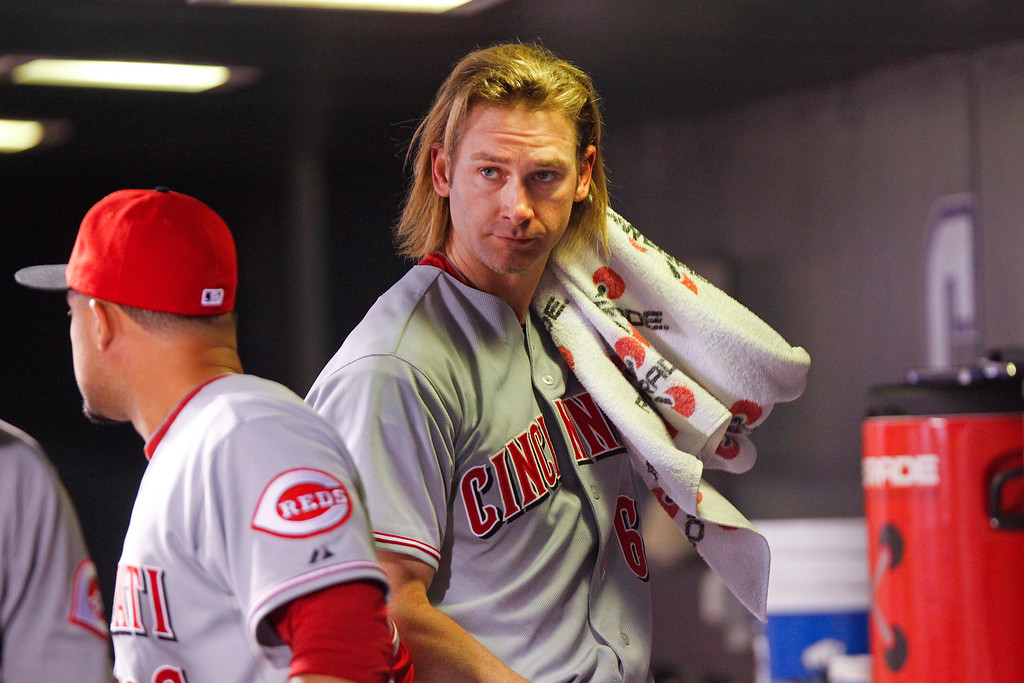 . Cincinnati Reds starting pitcher Bronson Arroyo reacts in the dugout after being pulled during the fourth inning of a baseball game against the Colorado Rockies, Friday, Aug. 30, 2013, in Denver. (AP Photo/Barry Gutierrez)