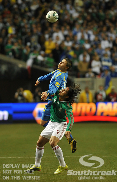 Mexico's Forward Aldo De Nigris (#9) tries to go after the ball in Soccer action between Bosnia-Herzegovina and Mexico.  Mexico defeated Bosnia-Herzegovina 2-0 in the game at the Georgia Dome in Atlanta, GA.